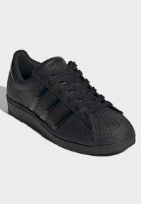 adidas Originals - SUPERSTAR SHOES - Sneaker low - black - 2