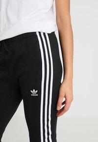 adidas Originals - REGULAR CUF - Træningsbukser - black - 4