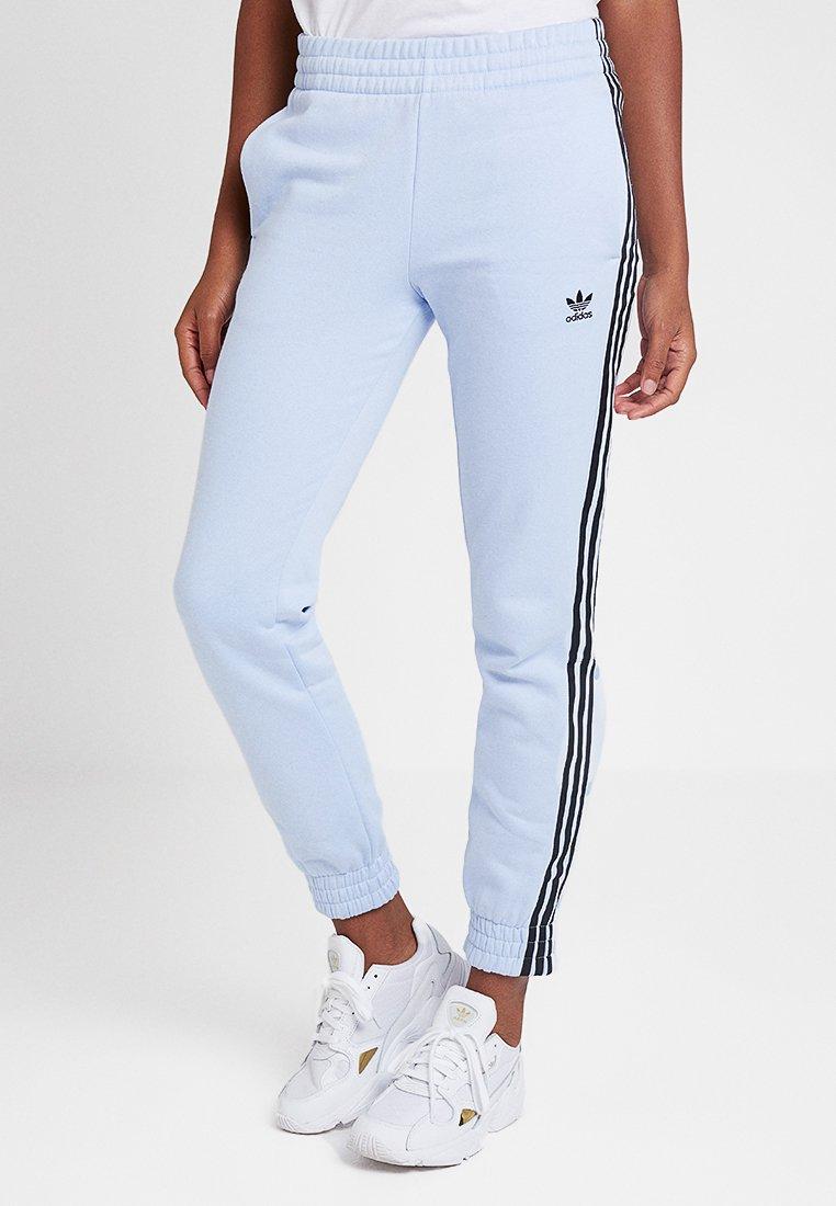 adidas Originals - CUFFED PANTS - Jogginghose - light blue