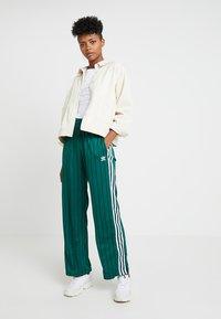 adidas Originals - TRACK PANTS - Teplákové kalhoty - collegiate green - 1