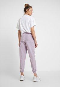 adidas Originals - LOCK UP - Jogginghose - purple - 2