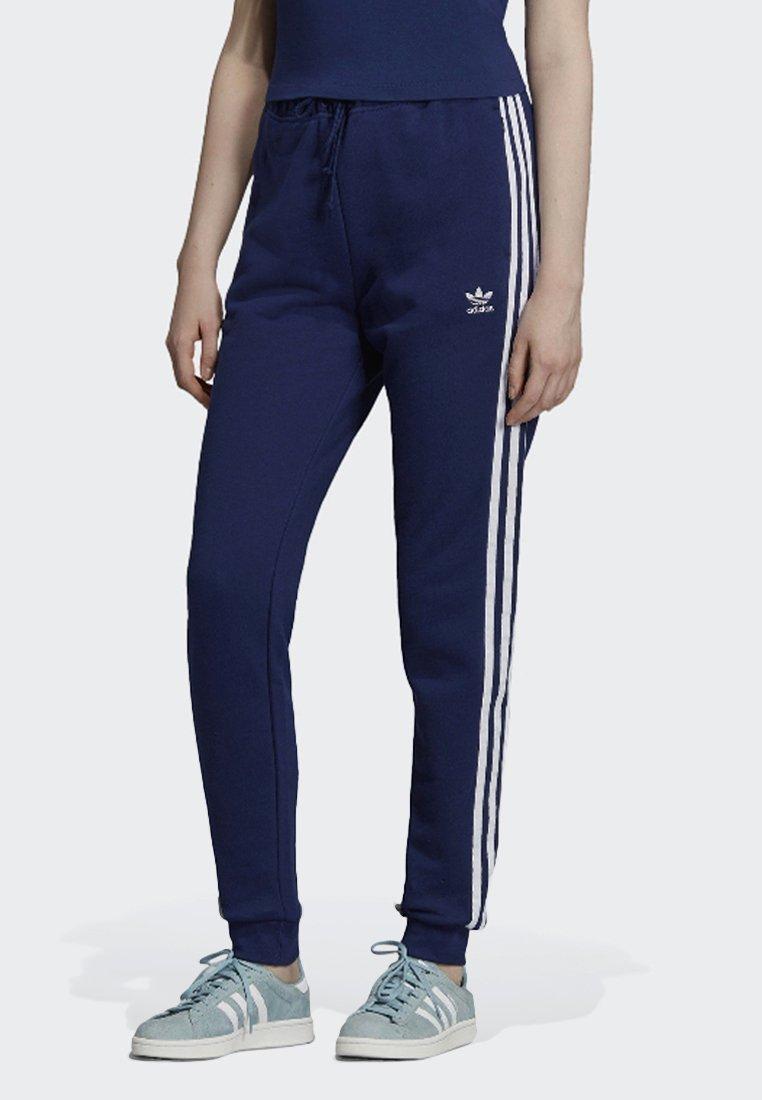 adidas Originals - CUFFED JOGGERS - Tracksuit bottoms - blue