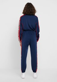 adidas Originals - TRACK PANTS - Verryttelyhousut - collegiate navy - 2