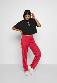 adidas Originals - FIREBIRD - Pantalon de survêtement - lusred/white - 1