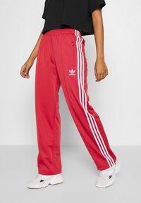 adidas Originals - FIREBIRD - Pantalon de survêtement - lusred/white - 0