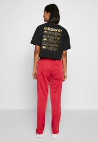 adidas Originals - FIREBIRD - Pantalon de survêtement - lusred/white - 2