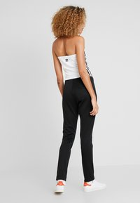 adidas Originals - TRACK PANT - Teplákové kalhoty - black - 2
