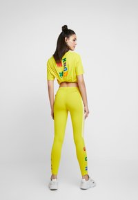adidas Originals - PHARRELL WILLIAMS 3 STRIPES TIGHT - Leggings - Trousers - yellow - 2