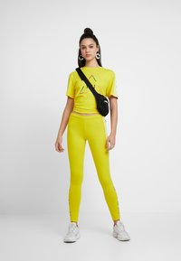 adidas Originals - PHARRELL WILLIAMS 3 STRIPES TIGHT - Leggings - Trousers - yellow - 1