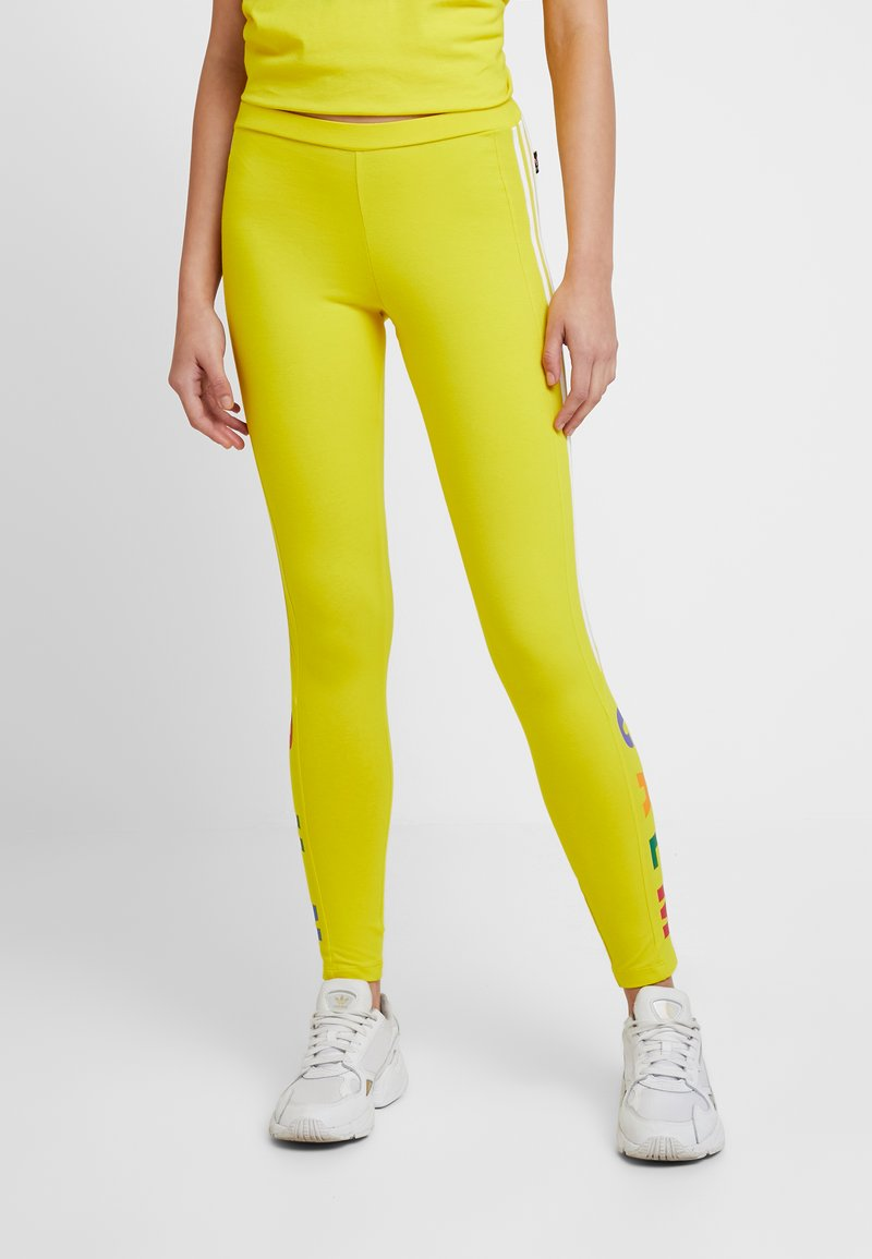 adidas Originals - PHARRELL WILLIAMS 3 STRIPES TIGHT - Leggings - Trousers - yellow