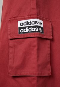 adidas Originals - TRACK PANTS - Tygbyxor - mystery red - 6