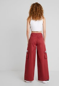 adidas Originals - TRACK PANTS - Tygbyxor - mystery red - 2