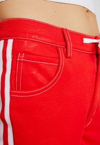 adidas Originals - TRACKPANT - Tracksuit bottoms - red - 5