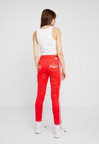 adidas Originals - TRACKPANT - Tracksuit bottoms - red - 2