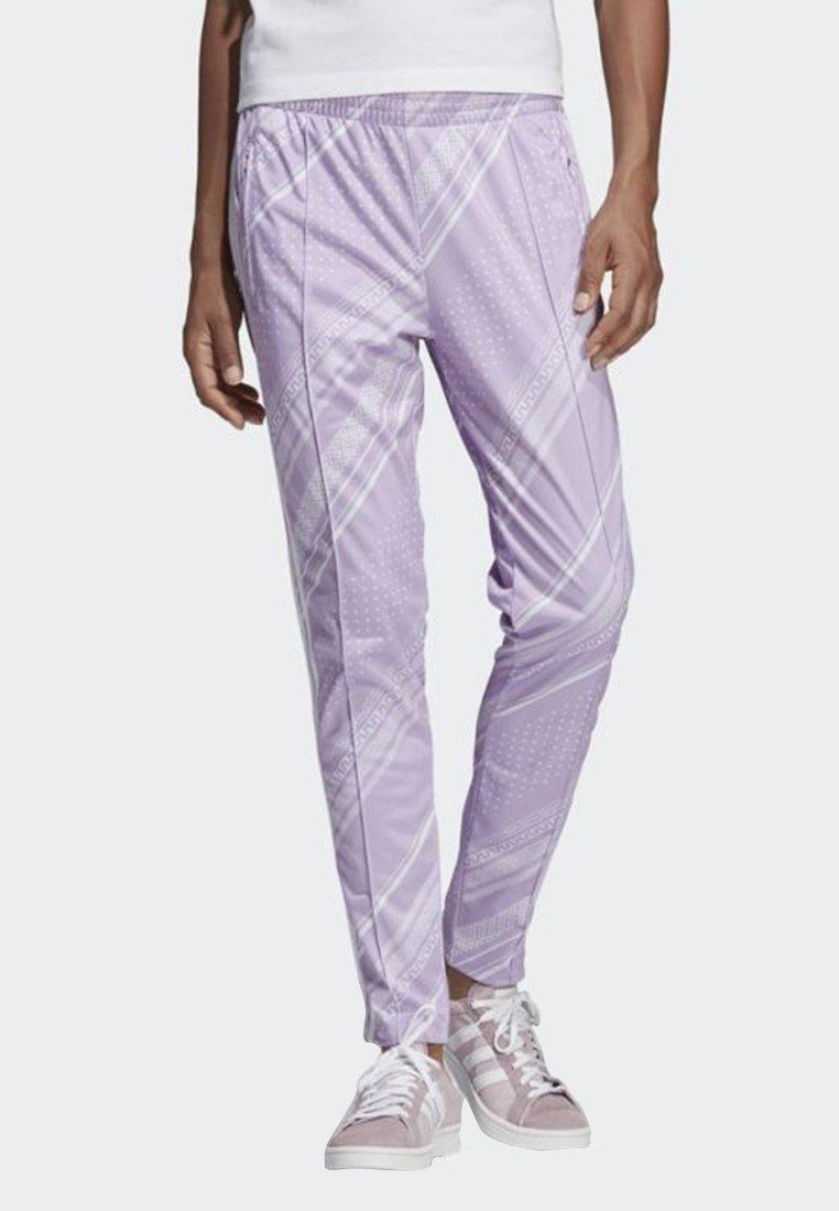 adidas Originals - SST TRACK PANTS - Tracksuit bottoms - purple
