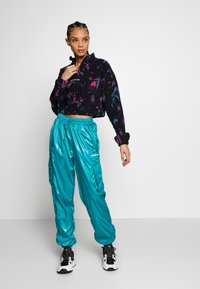 adidas Originals - SHINY WINDWEAR PANT - Träningsbyxor - blast emerald - 1