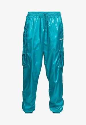 SHINY WINDWEAR PANT - Spodnie treningowe - blast emerald