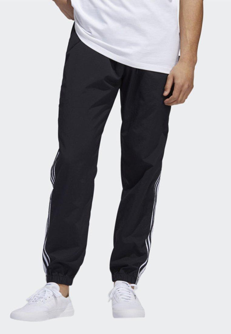 adidas Originals - STANDARD 20 WIND PANTS - Tracksuit bottoms - black