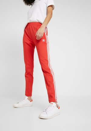 SUPERSTAR SUPER GIRL ADICOLOR TRACK PANTS - Tracksuit bottoms - lush red/white