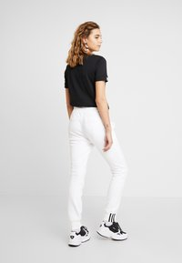 adidas Originals - CUFF PANT - Tracksuit bottoms - white - 2