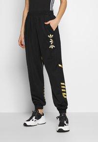 adidas Originals - LARGE LOGO ADICOLOR TRACK PANTS - Tracksuit bottoms - black/gold - 0