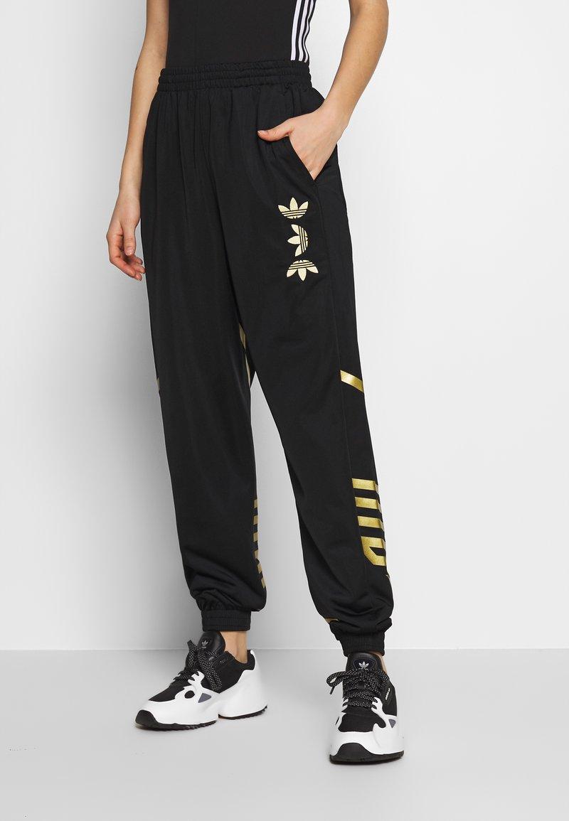 adidas Originals - LARGE LOGO ADICOLOR TRACK PANTS - Tracksuit bottoms - black/gold