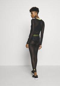 adidas Originals - FIORUCCI INLINE SHEER TRANSPARENT TIGHTS - Leggings - Trousers - black - 2