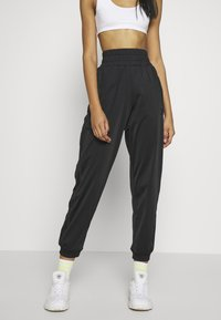 adidas Originals - Pantalon de survêtement - black - 0