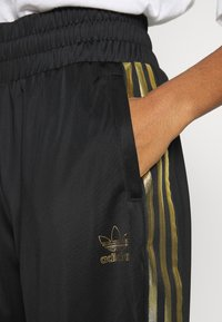 adidas Originals - 3STRIPES HIGH WAIST TRACK PANTS - Tracksuit bottoms - black - 3