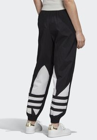 adidas Originals - Tracksuit bottoms - black - 1