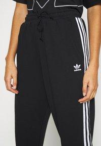 adidas Originals - Tracksuit bottoms - black - 4