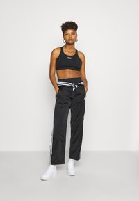 adidas Originals - FIREBIRD - Joggebukse - black - 1