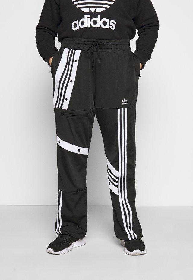 CATHARI - Pantalones deportivos - black