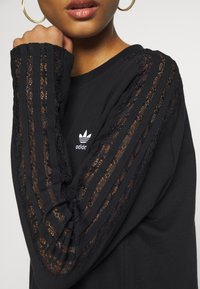 adidas Originals - BELLISTA TREFOIL LONGSLEEVE LACE DRESS - Trikoomekko - black - 4