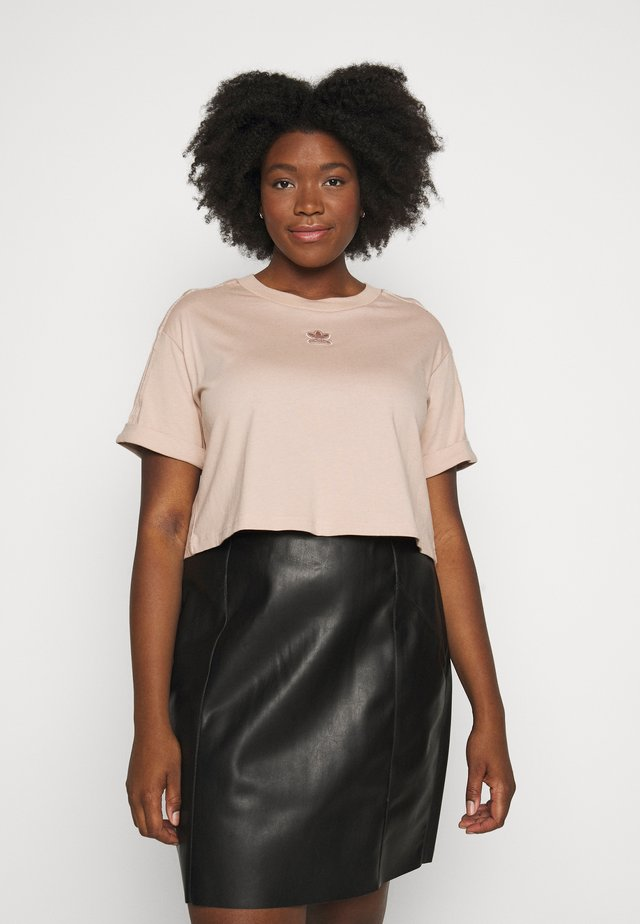 CROP - T-shirt con stampa - ash peach
