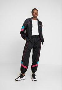 adidas Originals - TECH TRACK - Training jacket - black - 1