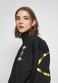 adidas Originals - LOGO - Verryttelytakki - black/gold - 3