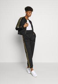 adidas Originals - SUPERSTAR 2.0 SPORT INSPIRED TRACK TOP - Sportovní bunda - black - 1