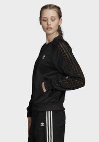 adidas Originals - LACE TRACK TOP - Bomber Jacket - black - 2