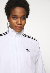 adidas Originals - ADICOLOR SPORT INSPIRED NYLON JACKET - Vindjakke - white - 3
