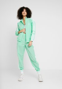 adidas Originals - LOCK UP - Summer jacket - prism mint/white - 1