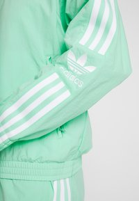 adidas Originals - LOCK UP - Summer jacket - prism mint/white - 4