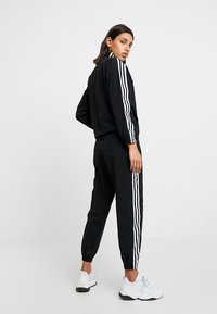 adidas Originals - ADICOLOR SPORT INSPIRED NYLON JACKET - Wiatrówka - black