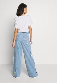 adidas Originals - TRACKPANT - Flared Jeans - clear sky - 2