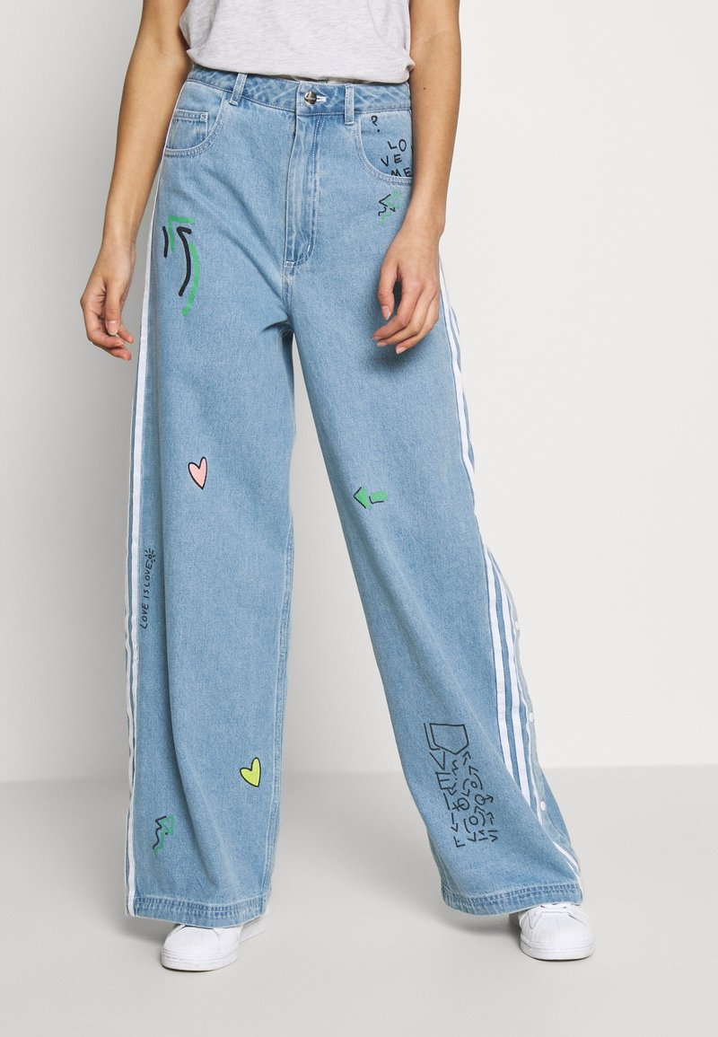 adidas Originals - TRACKPANT - Flared Jeans - clear sky
