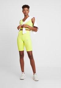 adidas Originals - CYCLING SHORTS - Shorts - semi frozen yellow - 1