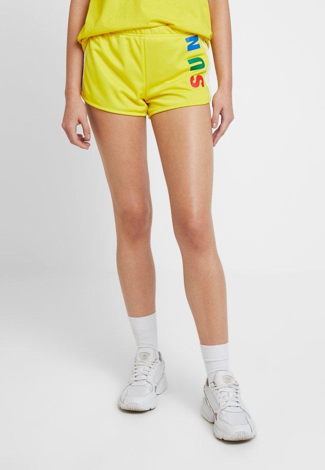 PHARRELL WILLIAMS 3 STRIPES - Shorts - yellow