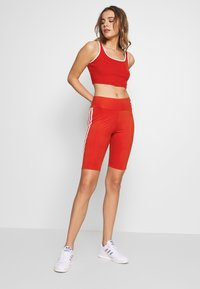 adidas Originals - ORIGINALS HIGH WAISTED TIGHTS - Shorts - lush red/white - 1
