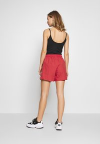 adidas Originals - Shorts - lush red/white
