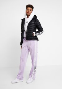 adidas Originals - SLIM JACKET - Light jacket - black - 1